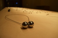 A Czech couple, Jana Slovakova and Radim Slovakdesigns, designed these metal magnetic balls as necklaces and earrings. They work in Jara Design, which key idea is based on a logical contradiction of a minimalistic jewel and soft lines of human body. Jana said that balls are easy to make.